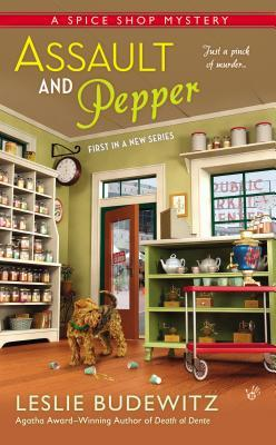 Picture of shop with canisters on shelves, teapots on other shelves, spilled cups on floor and a brown terrier dog