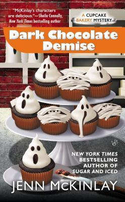 Dark Chocolate Demise by Jenn McKinlay book cover - Two-tiered cupcake stand sitting on granite counter - cake stand is holding cupcakes decorated as ghosts and mummies