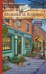 """Murder is Binding book cover - Store front for """"The Cookery"""" which also advertises cook books - cat under street lamp, bag and knife on sidewalk"""