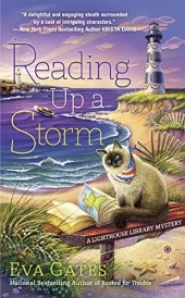 Reading up a Storm by Eva Gates book cover - Lighthouse and ocean in the background - sandy beach, bench with books, and cat in foreground