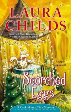 Scorched Eggs by Laura Childs book cover - gazebo decorated with white lights, table inside gazebo with ceramic chicken and tea service