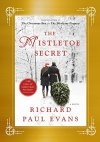 The Mistletoe Secret Book Cover - couple dragging a pine tree thru snow