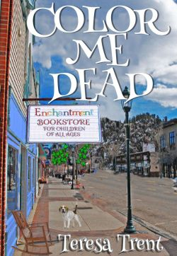 "Book Cover: Color Me Dead by Teresa Trent - View looking down a small town's main street - sign that says ""Enchantment Bookstore for Children of all ages"" hanging off building with a beagle underneath on the sidewalk along with a rocking chair"
