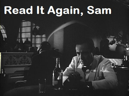 Humphrey Bogart sitting at a table drinking with text Read it Again, Sam