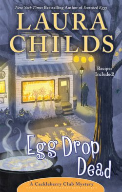 Book cover with front of cafe with corn stalks, jack o lanterns, and a cauldron of egg drop soup