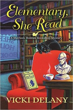 Elementary, She Read: A Sherlock Holmes Bookshop Mystery by Vicki Delany book cover - bookstore setting, red easy chair with a black cat on the back of it and a copy of Adventure of Sherlock Holmes on the seat.