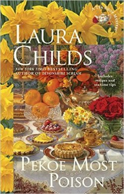 Pekoe Most Poison by Laura Childs book cover - A Tea Shop Mystery - border of daffodils - picture of a table set for tea with tarts, tea pots, flowers, fresh oranges, and quiche.