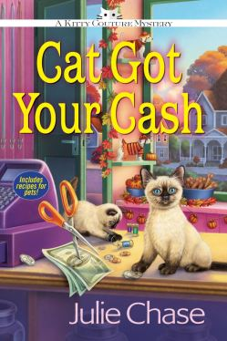 Book Cover: Cat Got Your Cash by Julie Chase - Shop decorated for fall in background - counter with money, scissors, cash register and 2 siamese kittens sitting on it in foreground