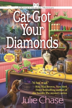 Book Cover: Cat Got Your Diamonds: A Kitty Couture Mystery by Julie Chase - Store setting on cover with black & white cat on top of counter and beagle on the floor looking up at it.