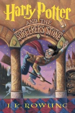 Harry Potter and the Sorcerer's Stone by J.K. Rowling book cover - Harry is flying on a broom through an arch and pillars trying to catch the golden snitch with Hogwarts and the Forbidden Forest in the background