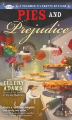 Book Cover: A Charmed Pie Shoppe Mystery: Pies and Prejudice by Ellery Adams - Inside a pie shop with numerous pies on pedestals and shelves behind a glass partition