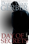 Book Cover: Day of Secrets by Daryl Wood Gerber - Background is grey - man is standing in dark colored clothing facing away from the audience. There's a gold locket in his hand.