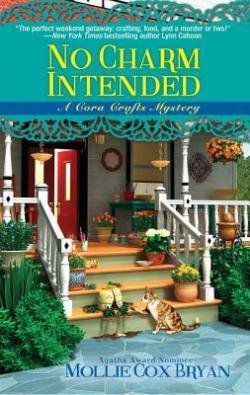 Book Cover: No Charm Intended - A Cora Crafts Mystery by Mollie Cox Bryan - Front of a house with pots of flowers sitting on the steps. A tabby cat is sitting in the foreground.