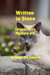 Book Cover: Written in Stone - Cobble Cove Mystery #3 by Debbie DeLouise. Photo of a Siamese cat laying on a stone wall with the lettering over top in yellow.