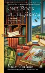 "Book Cover: One Book in the Grave - A Bibliophile Mystery by Kate Carlisle - ""A first edition fairy tale may lead to a grim ending..."" - Background includes a floor to ceiling bookshelf with an orange tabby sitting on it and birds flying outside an open window - Foreground has a desk with books piled, book restorer tools, and a copy of Beauty & the Beast"