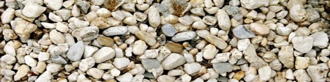 Line of small rocks and pebbles all jumbled together